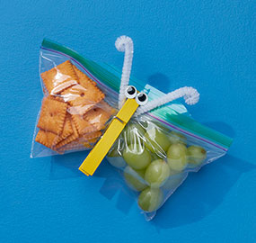 Ziploc Easy Open Tabs bag, snacks, clothespin, grapes, cheese snacks, googly eyes, pipe cleaners, blue, yellow, green.